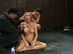 Rain DeGrey the blonde chick lies on the floor being tied up. She gets fingered and toyed by Isis Love. After that the brunette toys her vagina with a vibrator.