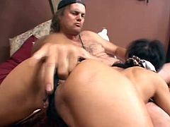 Blindfolded dark-haired mom pleases some guy with a passionate blowjob. Then she stands on all fours and allows the guy to drill her butt doggy style.