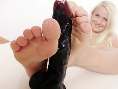 I like to keep my feet nice and soft so some lotion always does the job right. Wanna know why I like keeping my feet so soft? Well, it's because I love to rub cock with them. The feeling of a hard dick between by toes makes me horny as hell, watch me as I demonstrate with this black dildo!