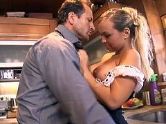 Curvaceous blonde in sexy housemaid uniform sucks a dick and gets fucked from behind in a kitchen. Then the dude licks and toys her vagina with the banana. Later on she starts to fuck her on a table.