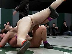 Horny chicks wrestle in a ring in team vs team fight. Girls from the losing team get toyed and fingered rough.