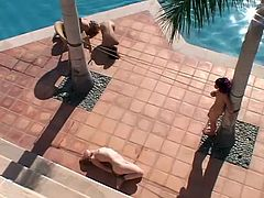 Three submissive girl get tied up and tortured with claws outdoors. Their master does what she wants with this chicks.