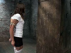 Slender brunette girl in stockings and a miniskirt gets severely bound by her master. Then he fingers and toys her wet vagina roughly.