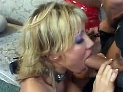 Anna Nova and Ava Devine are two slutty blondes with massive boobs who wear latex outfits. They serve as holes for this guy's cock. He fucks their faces deep.