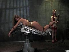 A busty bitch gets her cunt toyed to orgasm by a hot nurse