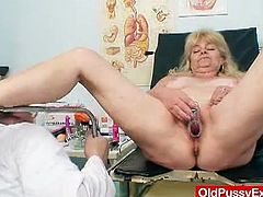 This blonde granny made an appointment with her gynecologist for an internal pussy washing. He examined her and then he used a huge syringe to wash her hole.