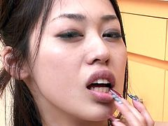 Petite bodied Asian porn actress is sitting down on her knees while sucking two hard dicks deepthroat. She performs awesome cock sucking skills.