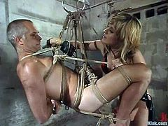 Ed Stone and Tyla Wynn are having fun in a basement. The blonde mom binds the guy and beats him and then stuffs his asshole with a long stick.