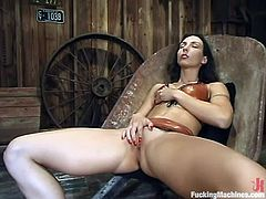 Hot brunette in stockings fondles her titties. Then she gets her vagina and ass toyed by the fucking machine at the same time.