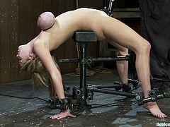 Curvaceous blonde girl with huge tits gets tied up. She also gets her boobs twisted so that they become claret and blue. In addition she gets her vagina toyed deep.