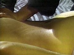 Horny curly haired brunette Asian MILF Linda Wong provides her partner with oily back massage. Check out her long sexy legs in black stockings.