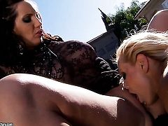 Blonde Kelly Divine with massive breasts finds herself getting her hole rubbed by lesbian Sandy