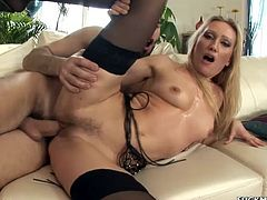 Hot blonde milf Natasha Kravzova is trying hard to satisfy some guy. They pet each other ardently and then fuck in cowgirl and some other positions.