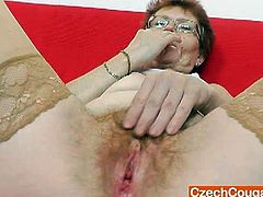 Jindriska is an old skank. She reveals her shaggy tits and starts playing with her big nipples. Then, she puts a vibrator between her moist and hairy cunt lips.