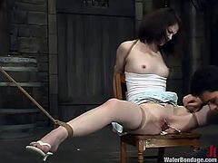 Cute brunette Faith Leon gets bound and tortured in a basement. Wolf Lotus attaches leads to Faith's tits and fucks her pussy with a dildo and she moans loudly with pleasure.