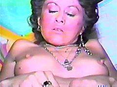 Kinky brunette is having fun with some dude in a retro sex scene. She gives a blowjob to the man, then takes his schlong into her snatch and they fuck in the reverse cowgirl position.