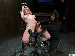 Hot blonde slut Darling lets Isis Love attach lots of clothes pegs to her tits. Then she takes a fucking machine's attachment to her cunt and gets it drilled remarcably well.