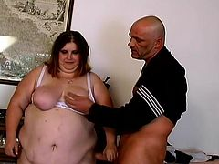 Obese brunette Hilda is playing dirty games with some bald stud indoors. She lets him fuck her twat in side-by-side position and then gets her pink slit pounded with a dildo.