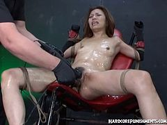 Hardcore Punishments brings you a hell of a free porn video where you can see how a vicious Asian slave gets tortured by two evil masters til she cums VERY hard.