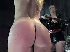 Submissive girl gets tied up and spanked by two chicks in latex dresses. Then she gets her ass spanked and pussy toyed by Dia Zerva and Lorelei Lee.