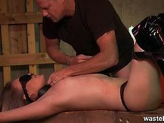 Female sex slave in knee high boots blindfolded with cock stuffed in her mouth.See this horny master is fucking her mouth with his big cock while slapping her face and spitting on her.