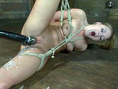 Amazing blonde girl gets tied up and covered with wax. Later on she gets her pussy toyed and ass stuffed with a hook.