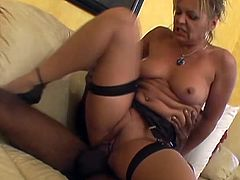 She gets on her knees and crawls to her horny black stud, begging for his massive cock. He gives it to her hard and deep and wrecks her pussy.