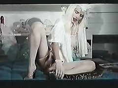 Perverted blonde in stockings masturbates her snatch while talking on a phone