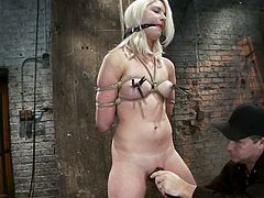 Amazing blonde girl in stockings gets tied up and gagged. Then the master fixes clothespins to her boobs. Later on Natasha also gets her vagina toyed with a vibrator.