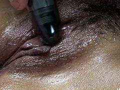 Mind blowing Japanese beauty gets her huge soft tits massaged with lots of oil. Japanese mommy opens her legs wide and gets her hairy pussy diddled with egg vibrators.