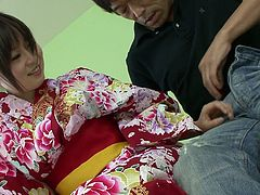 Shiny Japanese geisha with pale skin and natural tits Nozomi Hazuki looses her kimono and lets one dude suck her soft tits and rub her sensitive cunt.