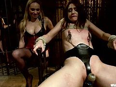 Curvaceous Kelly gets gagged and tied up by her mistresses. Then she gets her pussy licked and ass whipped sorely.