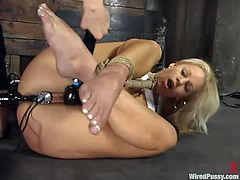 Blonde cutie Mia Bangg gets bound in a basement. Some slut puts a gag into Mia's mouth and then torments the cutie and fucks her vag with a strapon.
