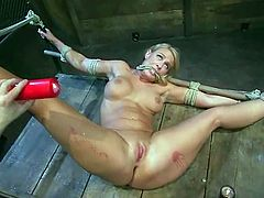 Smoking hot blonde girl with big boobs gets tied up and gagged. Then her master pours hot wax on her nude body and toys the pussy with big dildo.