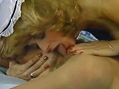 Slutty lesbo housemaid with massive ass enjoys licking her master's wife's soaking wet hairy cunt in 69 pose. Her big booty looks hypnotizing!