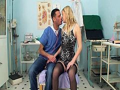 Beautiful blonde chick in sexy stockings seduce young doctor and she grabs his cock immediately to make it hard as a rock. She begs him to stick it deep into her cunt!