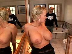 Busty blonde sucks a cock and gets her feet licked in a bathroom