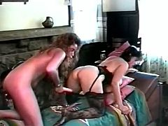 Bosomy brunette girl in black stockings bends over exposing her big ass while curly blonde lesbian bangs her soaking cunt with big dildo.
