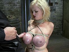 Blonde chick with huge tits gets tied up and then face fucked by her master. Then he twists her boobs roughly.