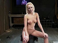 Petite blonde babe gets tied up to the wall and then undressed. She gets her tits tortured with pumps and claws. After that she also gets toyed with a vibrator.
