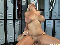 Extremely busty blond floozy Bridgette B gets her snapper fucked by big cock missionary style at the locker room. Horny bitch rides that massive dick in reverse cowgirl pose shaking her melons up and down.