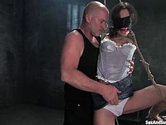 Sexy babe gets undressed and then tied up by Mark Davis. After that she blows his big dick and gets fucked from behind.