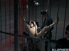 This cute Japanese woman is in prison. One night two guards come in to see her and one is a female guard. The prisoner has her legs spread and the female guard sticks a dildo in her face before fucking her with it.