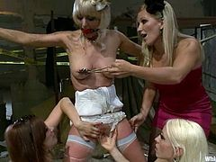 Cherry Torn the blonde girl in the wedding dress gets tied up and clothespins by her nasty bridesmaids. After that she also gets toyed with strap-ons and vibrators.