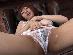 Neat dark haired Japanese hussy Tiara Ayase has a big tits and juicy puffy snatch. Asian gal takes off her undies and pets her clam with magic wand.