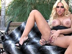 Big tits blonde cougar Carmel Moore makes wonders during her sexy outdoor solo show