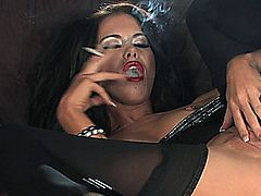 small boobed english bird smokes and pays with herself