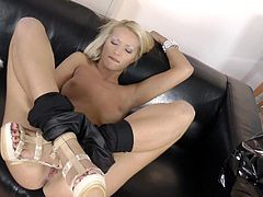 Blonde Cherry Kiss finger fucks her shaved twat before starting to suck on a hard cock