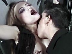 This kinky babe gets a hard ass spanking for a manly mistress. After she spanks her, she ties her hands above her head and starts torturing her erect nipples.