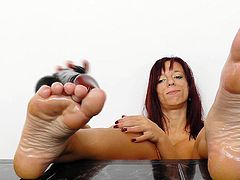 These feet are made for walking but I'm pretty good at rubbing cock with them too! Check me out how I practice my cock rubbing skills with this black dildo. First, I oil up my feet and then I slide them on the sex toy, pretending it's a real dick. Maybe I could use a real cock, will I find one soon?